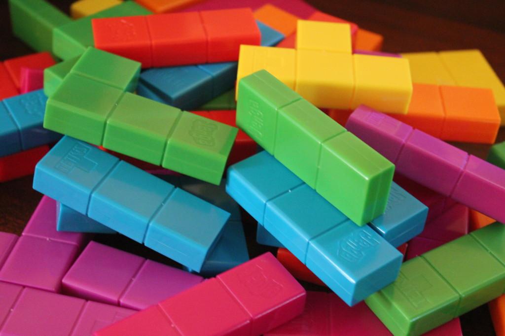 pile of jenga tetris pieces