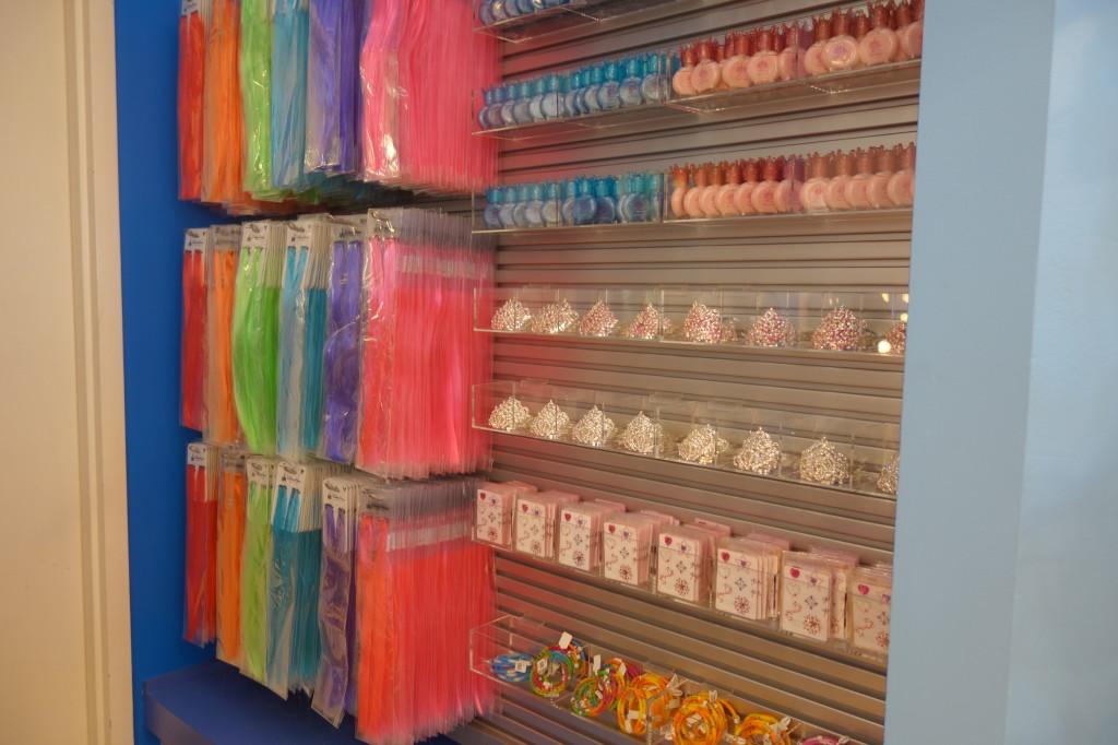 hair extentions, tiaras, nail polish wall at Anna & Elsa's Boutique