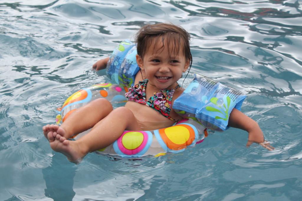toddler in pool tube