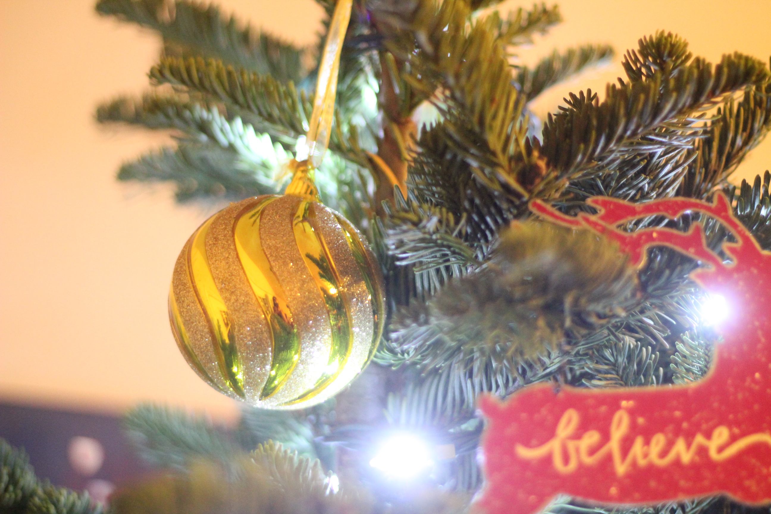 gold glitter glass ornament